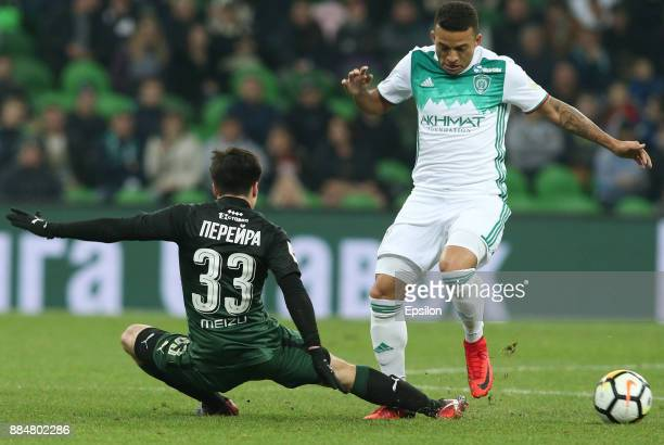 Mauricio Pereyra of FC Krasnodar vies for the ball with Ismael of FC Akhmat Grozny during the Russian Premier League match between FC Krasnodar and...