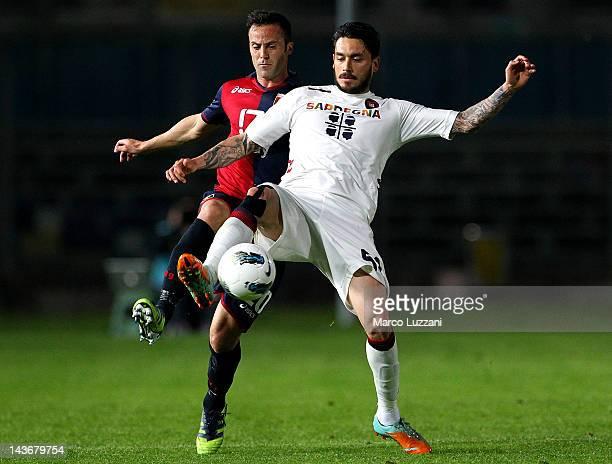 Mauricio Pinilla of Cagliari Calcio competes for the ball with Giandomenico Mesto of Genoa CFC during the Serie A match between Genoa CFC and...