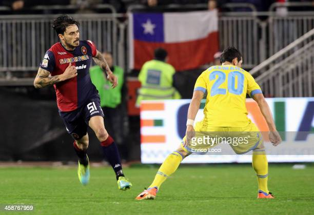 Mauricio Pinilla of Cagliari competes with Dzemaili Blerim of Napoli during the Serie A match between Cagliari Calcio and SSC Napoli at Stadio...