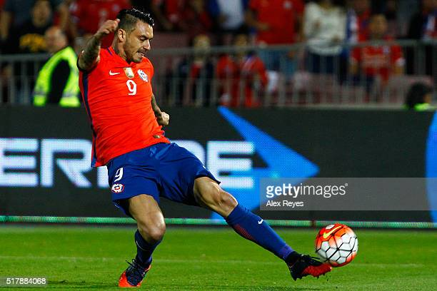 Mauricio Pinilla of Chile kicks the ball during a match between Chile and Argentina as part of FIFA 2018 World Cup Qualifiers at Nacional Stadium on...