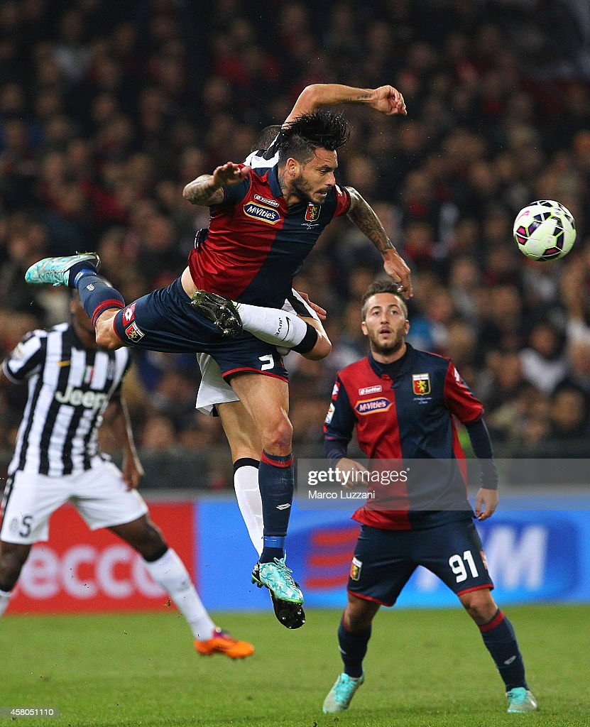 Mauricio Pinilla of Genoa CFC is challenged by Leonardo Bonucci of Juventus FC during the Serie A match between Genoa CFC and Juventus FC at Stadio...