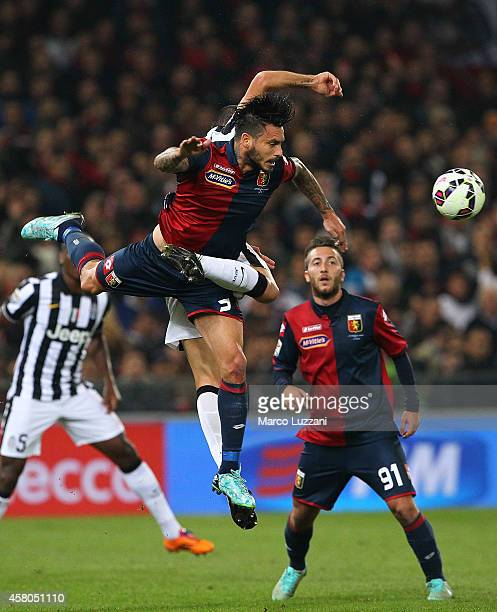 Mauricio Pinilla of Genoa CFC is challenged by Leonardo Bonucci of Juventus FC during the Serie A match between Genoa CFC and Juventus FC at Stadio...