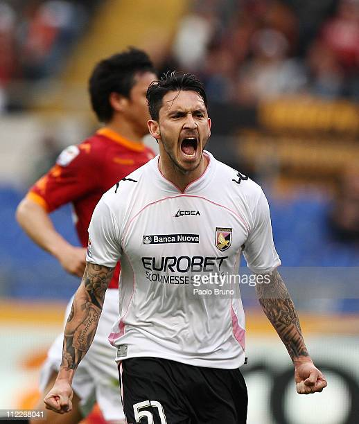 Mauricio Pinilla of US Citta di Palermo celebrates after scoring the 11 equaliser from a penalty during the Serie A match between AS Roma and US...