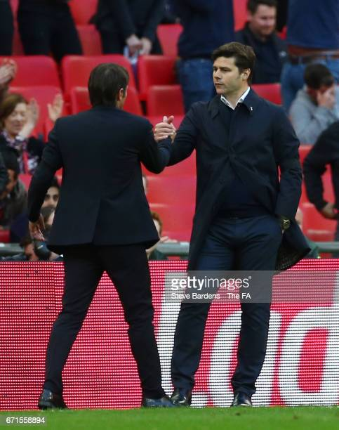 Mauricio Pochettino Manager of Tottenham Hotspur and Antonio Conte Manager of Chelsea shake hands during The Emirates FA Cup SemiFinal between...