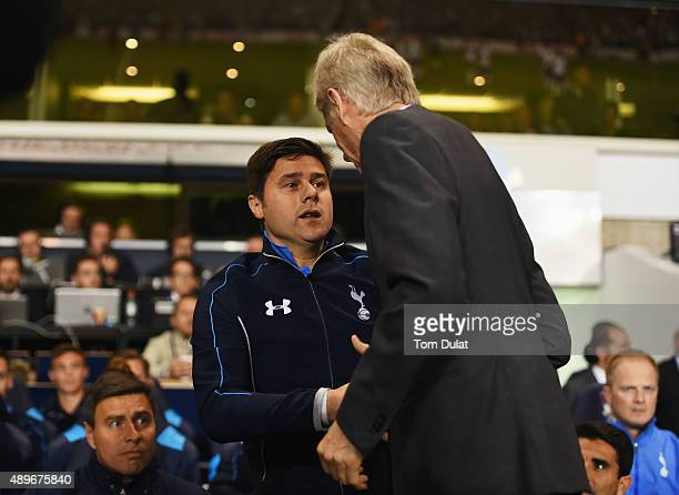 Mauricio Pochettino manager of Tottenham Hotspur and Arsene Wenger manager of Arsenal shake hands prior to the Capital One Cup third round match...