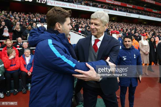 Mauricio Pochettino Manager of Tottenham Hotspur and Arsene Wenger Manager of Arsenal greet each other prior to the Premier League match between...
