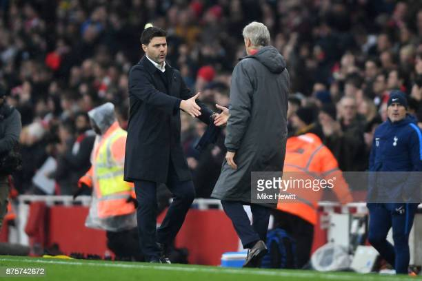 Mauricio Pochettino Manager of Tottenham Hotspur and Arsene Wenger Manager of Arsenal shake hands after the Premier League match between Arsenal and...