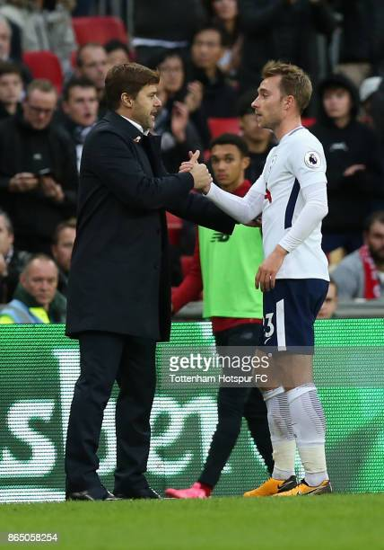 Mauricio Pochettino Manager of Tottenham Hotspur and Christian Eriksen of Tottenham Hotspur embrace after he is subbed during the Premier League...