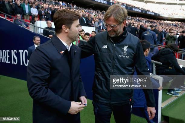 Mauricio Pochettino Manager of Tottenham Hotspur and Jurgen Klopp Manager of Liverpool shake hands priror to the Premier League match between...