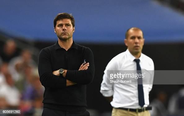 Mauricio Pochettino Manager of Tottenham Hotspur and Leonardo Jardim head coach of AS Monaco look on during the UEFA Champions League match between...