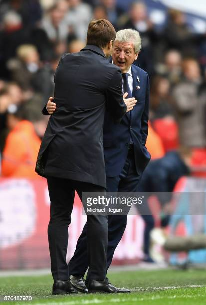 Mauricio Pochettino Manager of Tottenham Hotspur and Roy Hodgson Manager of Crystal Palace speak during the Premier League match between Tottenham...