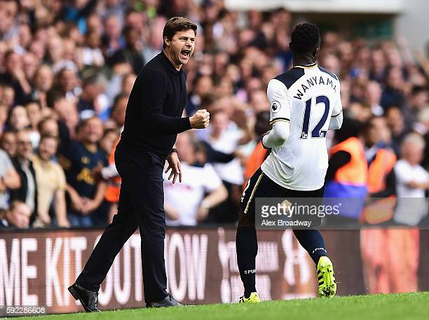 Mauricio Pochettino Manager of Tottenham Hotspur and Victor Wanyama of Tottenham Hotspur celebrate during the Premier League match between Tottenham...