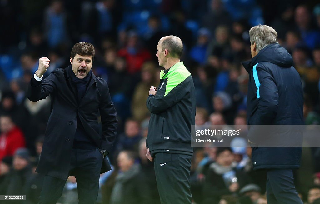 Mauricio Pochettino, Manager of Tottenham Hotspur celebrates victory with Manuel Pellegrini, Manager of Manchester City during the Barclays Premier League match between Manchester City and Tottenham Hotspur at Etihad Stadium on February 14, 2016 in Manchester, England.