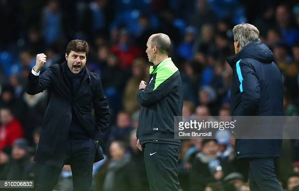 Mauricio Pochettino Manager of Tottenham Hotspur celebrates victory with Manuel Pellegrini Manager of Manchester City during the Barclays Premier...