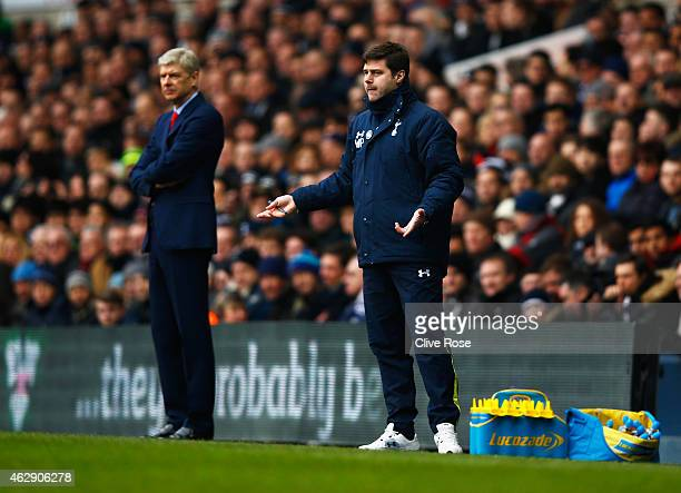 Mauricio Pochettino manager of Tottenham Hotspur gestures with Arsene Wenger manager of Arsenal during the Barclays Premier League match between...