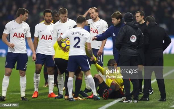 Mauricio Pochettino Manager of Tottenham Hotspur gives his team instructions as Richarlison de Andrade of Watford goes down injured during the...