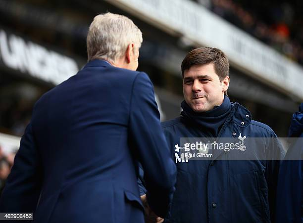 Mauricio Pochettino manager of Tottenham Hotspur greets Arsene Wenger manager of Arsenal during the Barclays Premier League match between Tottenham...