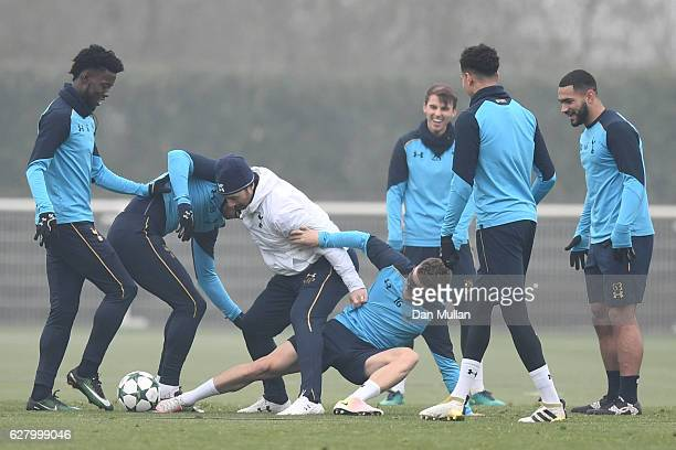 Mauricio Pochettino Manager of Tottenham Hotspur is tackled by Kieran Trippier of Tottenham Hotspur during the Tottenham Hotspur FC training session...