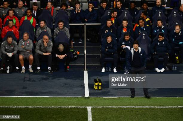 Mauricio Pochettino Manager of Tottenham Hotspur looks on as Arsene Wenger Manager of Arsenal looks dejected during the Premier League match between...