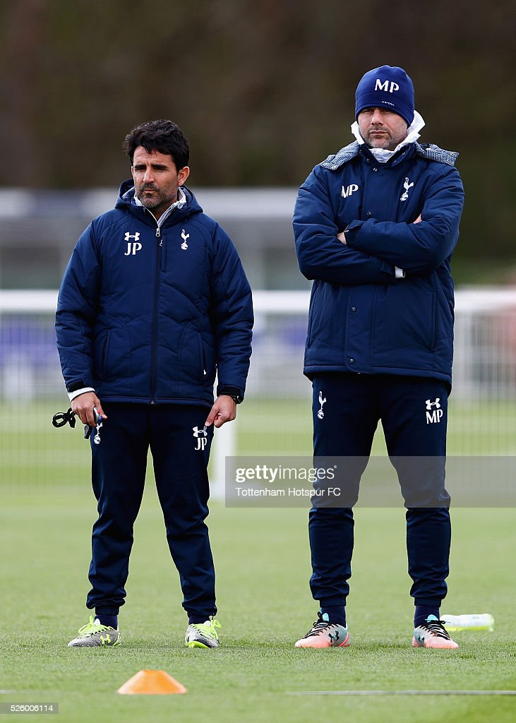 Mauricio Pochettino (R), manager of Tottenham Hotspur looks on with assistant head coach Jesus Perez during a training session at the club's training ground on April 29, 2016 in Enfield, England.