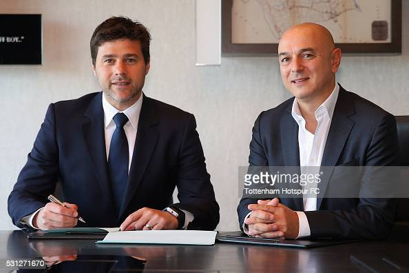 Mauricio Pochettino Manager of Tottenham Hotspur poses with Chairman Daniel Levy after signing a new contract until 2021 at the Tottenham Hotspur...
