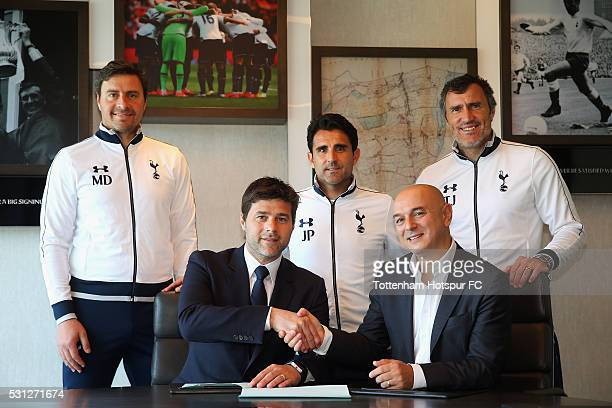 Mauricio Pochettino Manager of Tottenham Hotspur poses with Chairman Daniel Levy and his coaching staff after signing a new contract until 2021 at...