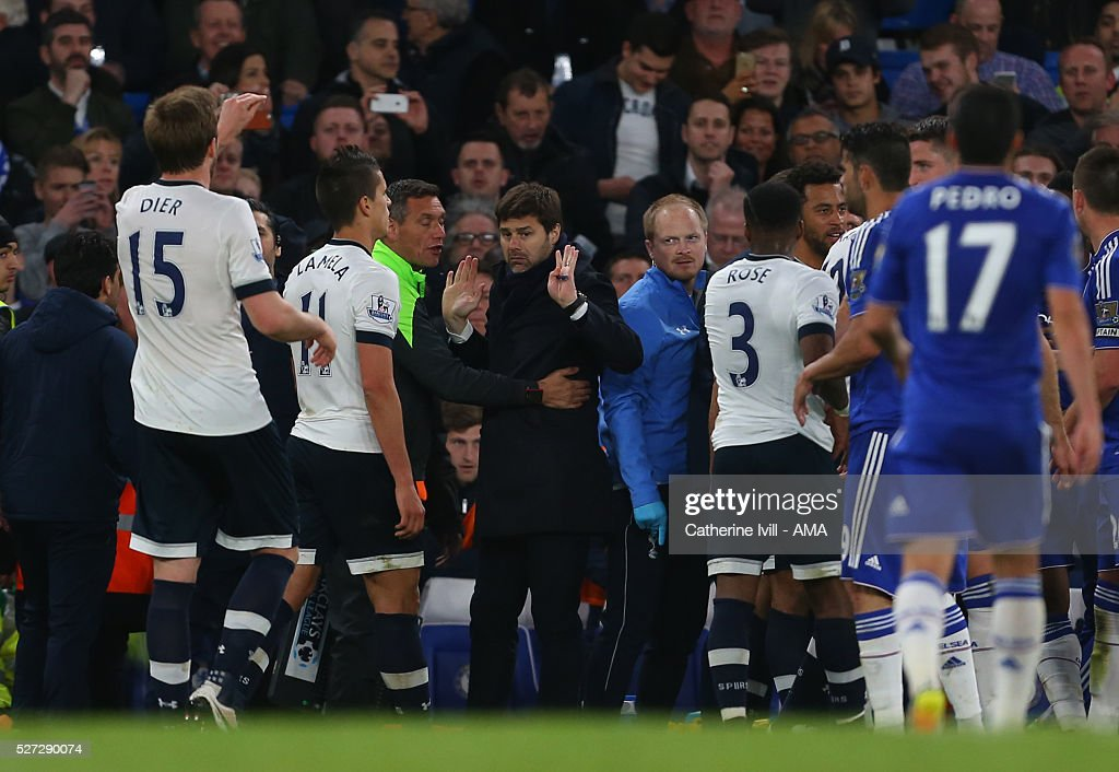 Mauricio Pochettino manager of Tottenham Hotspur puts his hands up as he is held back by fourth official Andre Marriner during the Barclays Premier League match between Chelsea and Tottenham Hotspur at Stamford Bridge on May 2, 2016 in London, England.
