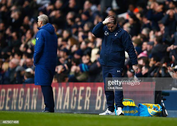 Mauricio Pochettino manager of Tottenham Hotspur reacts with Arsene Wenger manager of Arsenal during the Barclays Premier League match between...