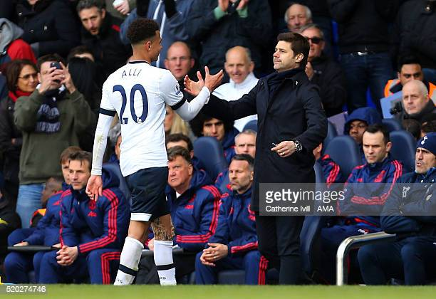 Mauricio Pochettino manager of Tottenham Hotspur shakes hands with Dele Alli of Tottenham Hotspur during the Barclays Premier League match between...