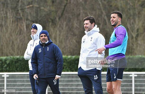 Mauricio Pochettino manager of Tottenham Hotspur smiles with Kyle Walker during a training session at the club's training ground on February 10 2016...