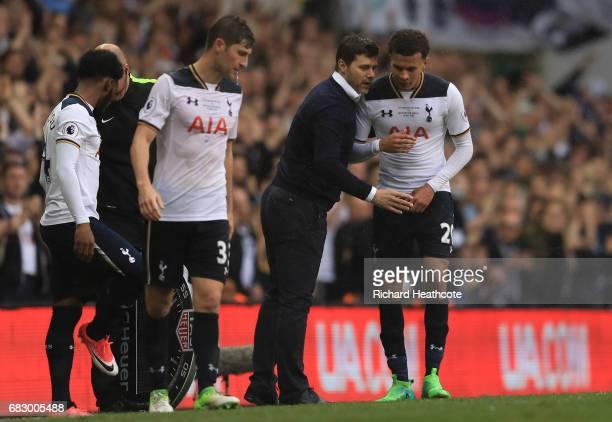Mauricio Pochettino Manager of Tottenham Hotspur speaks to Dele Alli of Tottenham Hotspur during the Premier League match between Tottenham Hotspur...