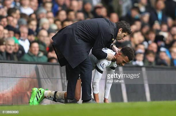 Mauricio Pochettino manager of Tottenham Hotspur talks to Dele Alli of Tottenham Hotspur during the Barclays Premier League match between Tottenham...