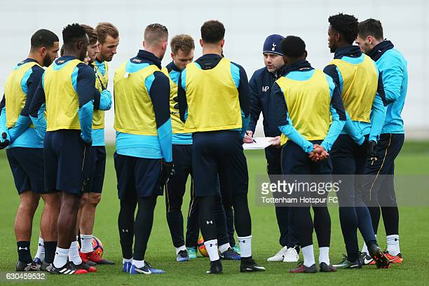 Mauricio Pochettino manager of Tottenham Hotspur talks to players during a Tottenham Hotspur training session at Tottenham Hotspur Training Centre on...