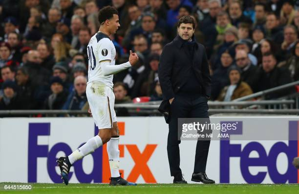 Mauricio Pochettino manager of Tottenham Hotspur watches as Dele Alli of Tottenham Hotspur leaves the pitch after being sent off during the UEFA...