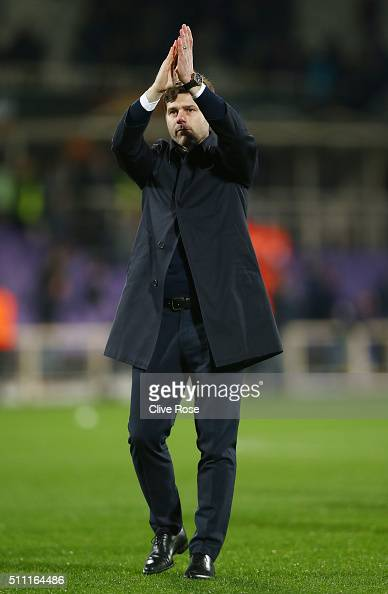 Mauricio Pochettino of Tottenham Hotspur applauds away supporters after the 11 draw in the UEFA Europa League round of 32 first leg match between...