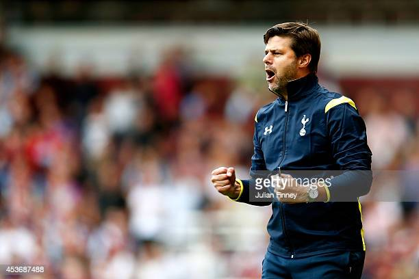Mauricio Pochettino the Spurs manager celebrates his team's goal during the Barclays Premier League match between West Ham United and Tottenham...