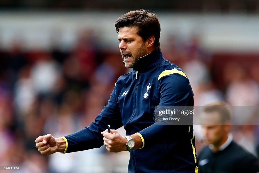 Mauricio Pochettino the Spurs manager celebrates his team's goal during the Barclays Premier League match between West Ham United and Tottenham Hotspur at Boleyn Ground on August 16, 2014 in London, England.