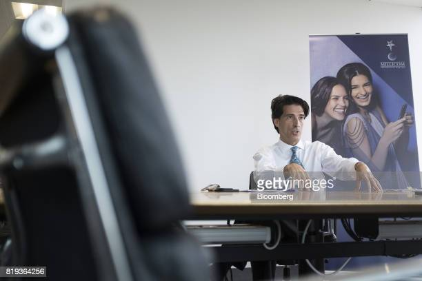 Mauricio Ramos chief executive officer of Millicom International Cellular SA gestures as he speaks during an interview in London UK on Thursday July...