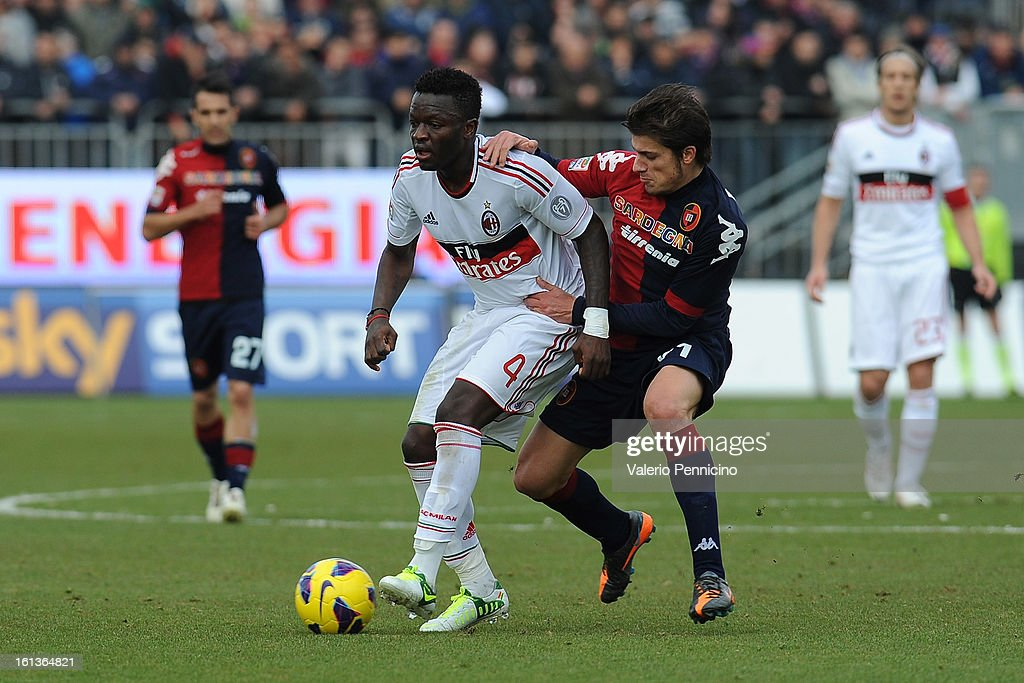 Mauricio Ricardo Pinilla (R) of Cagliari Calcio competes with <a gi-track='captionPersonalityLinkClicked' href=/galleries/search?phrase=Sulley+Ali+Muntari&family=editorial&specificpeople=533057 ng-click='$event.stopPropagation()'>Sulley Ali Muntari</a> of AC Milan during the Serie A match between Cagliari Calcio and AC Milan at Stadio Is Arenas on February 10, 2013 in Cagliari, Italy.