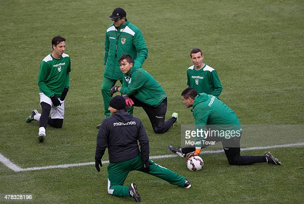 Mauricio Soria coach of Bolivia talks with his players at the end of a training session at German Becker Stadium on June 20 2015 in Temuco Chile Peru...