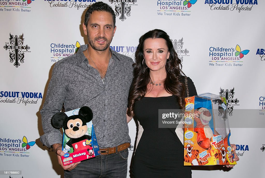 Mauricio Umansky (L) and actress Kyle Richards attend The Abbey's 8th annual Christmas in September event benefiting The Children's Hospital Los Angeles at The Abbey on September 24, 2013 in West Hollywood, California.