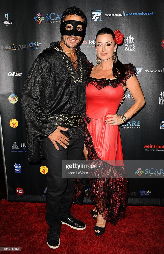 Mauricio Umansky and <a gi-track='captionPersonalityLinkClicked' href=/galleries/search?phrase=Kyle+Richards&family=editorial&specificpeople=2586434 ng-click='$event.stopPropagation()'>Kyle Richards</a> attend the sCare Foundation's 2nd annual Halloween benefit event at The Conga Room at L.A. Live on October 28, 2012 in Los Angeles, California.
