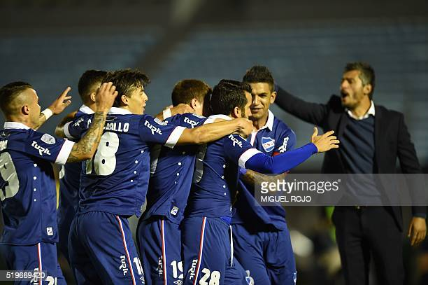 Mauricio Victorino of Uruguay's Nacional celebrates with teammates the goal against Uruguay's River Plate during their Libertadores Cup football...