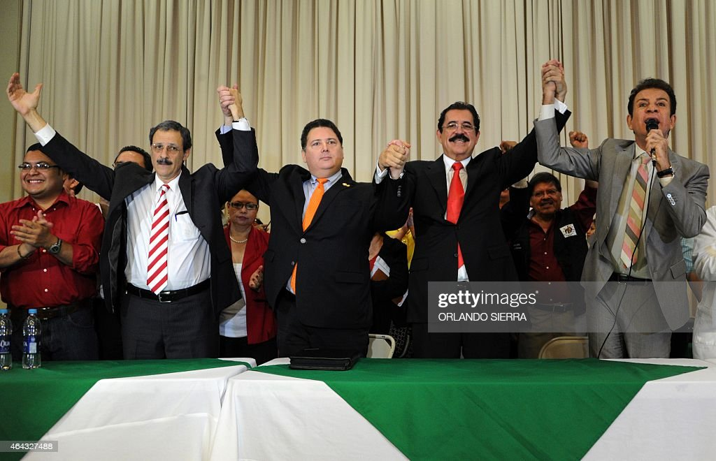 Mauricio Villeda, of the Partido Liberal (PL), Guillermo Valle, of the Innovacion y Unidad party, the leader of the Libertad y Refundacion (LIBRE) party, Manuel Zelaya and the president of the Anticorruption Party, Salvador Nasralla attend a press conference on February 24, 2015. Honduran opposition parties reject the re-election of President Juan Orlando Hernandez. AFP PHOTO/ORLANDO SIERRA
