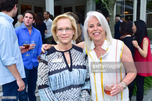 Maurie Perl and Ellen Krass attend NYSCF Summer Cocktail Reception at a Private Residence on July 28 2017 in Sagaponack New York