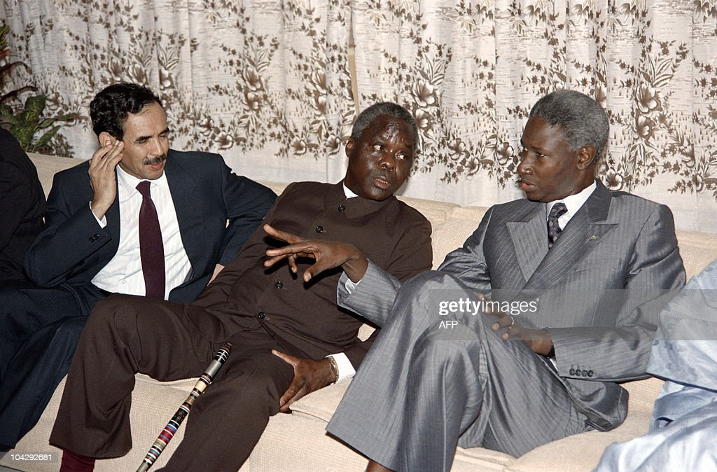, Mauritania's President Maaouya Ould Sid'Ahmed Taya, Benin's President Mathieu Kerekou and Senegalese President <a gi-track='captionPersonalityLinkClicked' href=/galleries/search?phrase=Abdou+Diouf&family=editorial&specificpeople=216412 ng-click='$event.stopPropagation()'>Abdou Diouf</a> confer before the opening of the ECOWAS (Economic community of the West African States) summit, on June 29, 1989 in Ouagadougou, Burkina Faso.