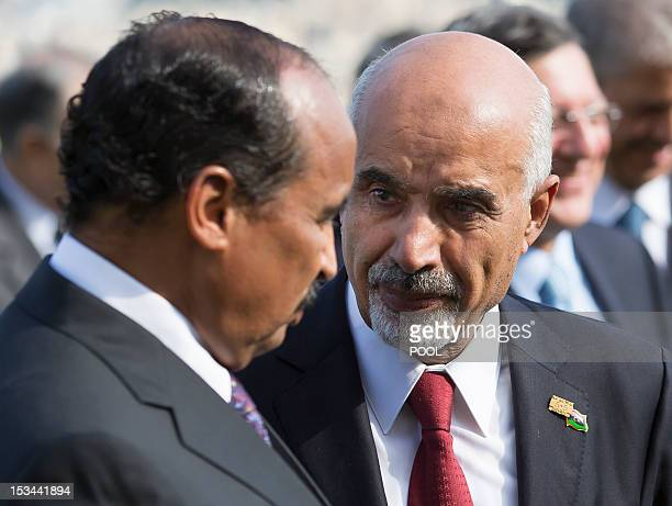 Mauritania's President Mohamed Ould Abdel Aziz speaks with Mohamed Yousef ElMagariaf President of the General National Congress of Libya after the...