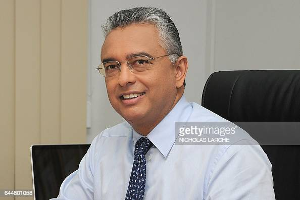 Mauritian Finance Minister Pravind Jugnauth smiles in his office in PortLouis on November 19 2010 / AFP / Nicholas LARCHE
