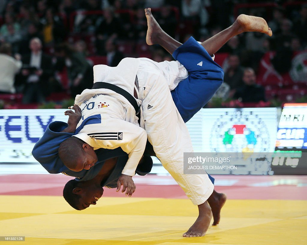 Mauritius' Macleon Paulin (white) fights against Cuba's Ivan Silva (blue) on February 10, 2013 in Paris, during the eliminatories of the Men - 81kg of the Paris Judo Grand Slam tournament.