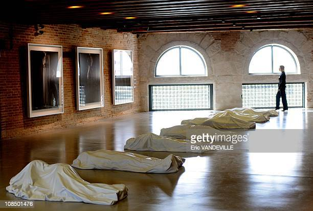 Maurizio Cattelan ' All ' Nine lifeless figures under sheets from Carrara marble a stark homage to the victims of the Sicilian Mafia French...